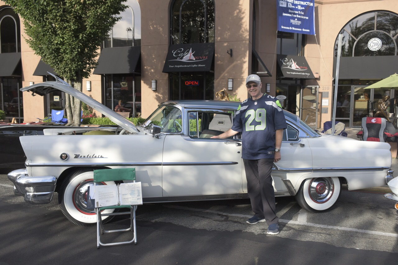 Bob Smith of Edmonds with his grandfather's 1955 Mercury Montclair. (Photo  by Chad Emerson)