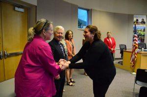 School Board member Carin Chase congratulates Mara Marano-Bianco, RN, the District's new Heath Services Manager.