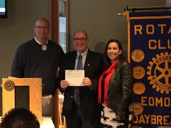 Chris Lindberg, Edmonds Daybreakers Rotary Club with Foundation board member Scott Barnes, Edmonds School District, and Executive Director Deborah Anderson.
