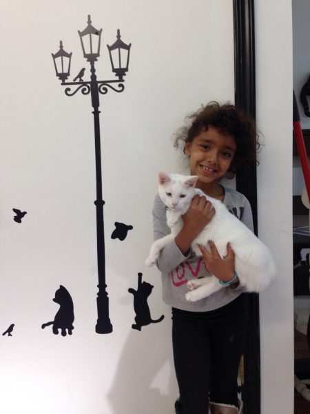 Kristina Thompson's daughter Isabella with Snowy.