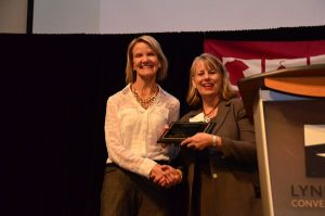 My Neighborhood News Network Publisher Teresa Wippel, left, receives the Community Partner Award from Clothes for Kids Executive Director Joy Ingraham.