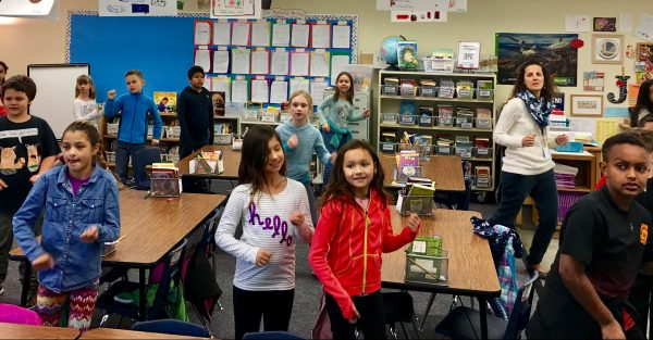 How to keep fidgety elementary school children on task? Give them an in-class break to wiggle, jump, dance and just be silly. That's what Westgate Elementary third-grade teacher Amy Jonart does daily when she lets her students follow the dance moves of videos on GoNoodle.com. The brain break helps improve performance and focus in the classroom while allowing children to stretch and move. (Photo courtesy Tanyalux Hodson, Westgate PSO liaison)