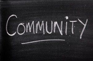 The word Community written on a blackboard