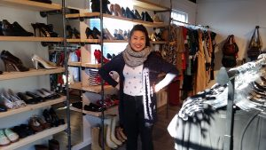 Owner Liz Le checks out the shoe racks in her new Anchor Chic boutique.