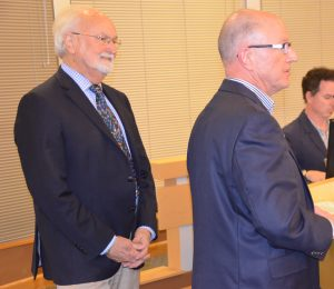 Retiring Verdant Superintendent Carl Zapora speaks to the councll as Edmonds Mayor Dave Earling looks on.