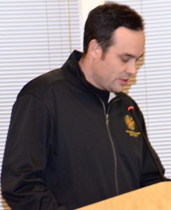 Fire District 1 firefighter/EMT A.J. Johnson testifies at the Dec. 6 public hearing in city council chambers.