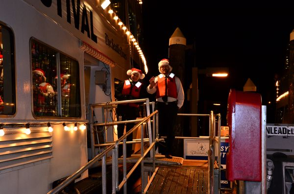 argosy deckhands in santa hats and red life vests greet passengers at the top of the gangplank - Argosy Christmas Ships 2014