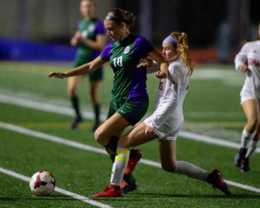 E-W's Chiara Serafini and Pilchuck's Brynn Pilkenton battle for the ball.