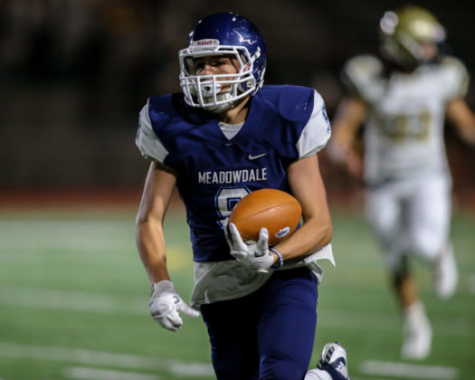 Meadowdale's Cutter Buchea running up the field for a touchdown