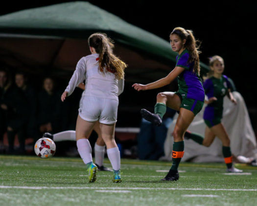 Gaby Chappell crosses the ball into the middle of the field