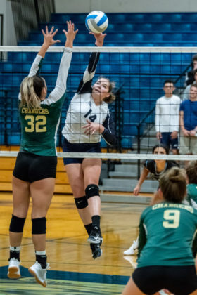 Middle Blocker Kaitlyn Robinson crushes one