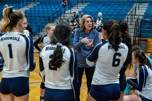 Head Coach Machen Shrum instructs her team during a time out.