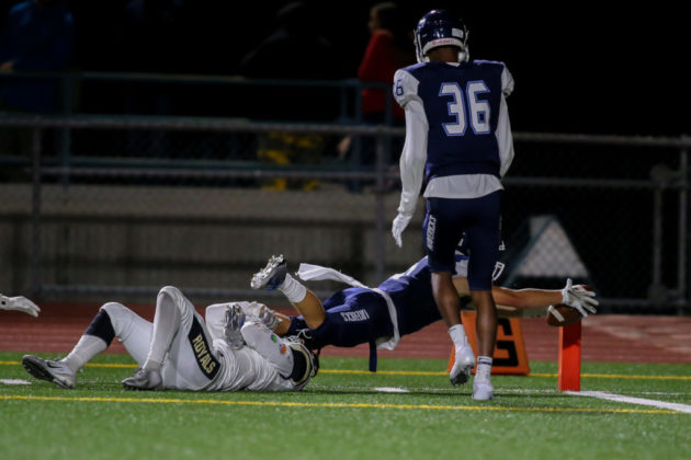 Tyler Gibson diving for a touchdown as Lynnwood's Ali Al-Mayyahi tries to tackle him
