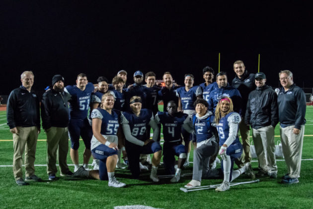 Seniors with the coaching staff.
