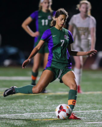Michaela Danyo puts a penalty kick in the lower left corner of the goal