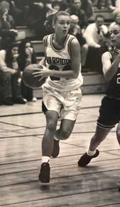 Basketball and volleyball champ Molly Hills on the court, circa 1994