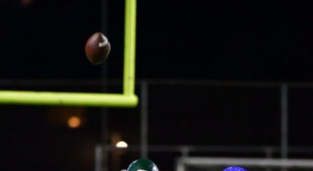 Relief Quarterback Read Carr throws