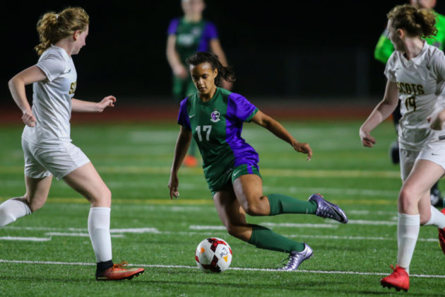 Sophia Martino-Crew dribbles between two of Shorecrest's defenders