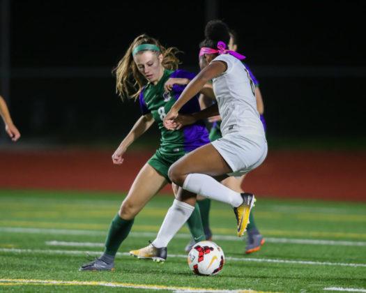Sophia Pellegrini stops Shorecrest's Amanda Kagarabi from getting a shot off inside the goal box