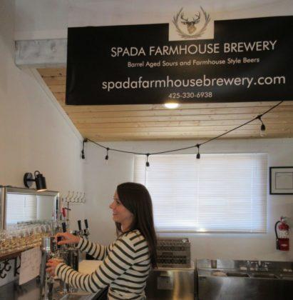 Spada Farmhouse-owner Johnn Spada's wife Emily pouring a beer