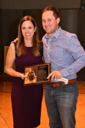 – Soccer and basketball champ Ben Somoza receives his award from Angie McGuire.