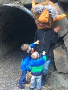 – Some in the community feel the troll is a victim of profiling, and is being prematurely and harshly judged. This photo, taken by Debbie Kruse of Edmonds shortly after the troll's arrival at the Main Street Troll Tunnel, shows his warm side as her children Corvin and Max pause to greet him and welcome him to the neighborhood..